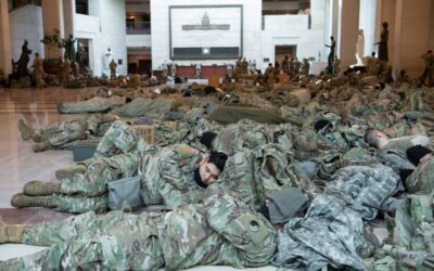 Prior to inauguration, several National Guard members rest on Capitol floors